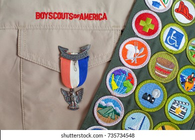 SAINT LOUIS, UNITED STATES - OCTOBER 16, 2017:  Eagle pin and merit badge sash on boy scouts of america uniform