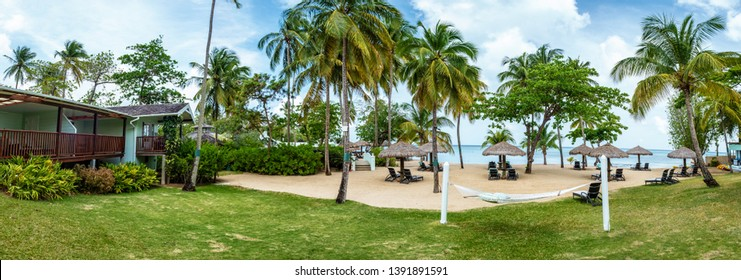 Saint Lucia Caribbean April 2019, luxury hotel at beach front with green cottages East Winds