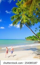 SAINT LUCIA, CARIBBEAN - DECEMBER 10, 2014: Senior couple walk by the beach in exotic resort in Saint Lucia, Caribbean