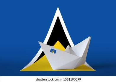 Saint Lucia flag depicted on paper origami ship closeup. Handmade arts concept