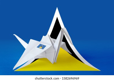 Saint Lucia flag depicted on paper origami crane wing. Handmade arts concept