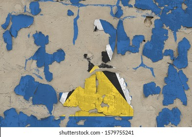 Saint Lucia flag depicted in paint colors on old obsolete messy concrete wall closeup. Textured banner on rough background