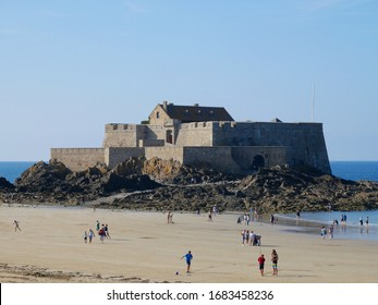 Saint Malo, France August 25 2019 Old castle with people spending a sunny day at the beach