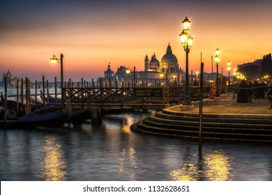 Saint Mark region by the lagoon during carnivale. View of gondolas and Santa Maria della Salute. Venice, Italy. February 12th 2015