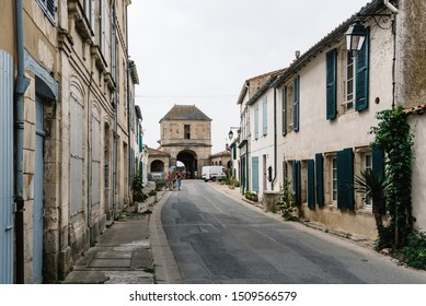 Saint Martin de Re, France - August 7, 2018: Street with traditional old houses in Saint Martin de Re. Island of Re