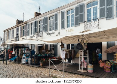 Saint Martin de Re, France - August 7, 2018: Shops in the quays of Saint Martin en Re. Island of Re