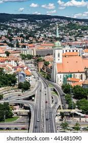 Saint Martin's cathedral and bridge SNP in Bratislava, Slovak republic. Architectural theme. Capital city. Cultural heritage. Travel destination. Beautiful place. Vertical composition.