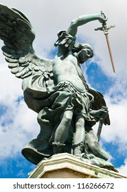 Saint Michael archangel statue at top of Castel Sant'Angelo, Rome, Italy. Michael the Archangel with wings on the sky background. The archangel holds a sword.