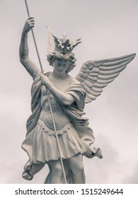 Saint Michael the archangel vanquishing evil with his lance against cloudy sky at the Sanctuary of Our Lady of Lourdes, major Catholic pilgrimage site in Hautes-Pyrenees, Occitanie, Southwest France