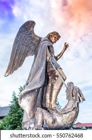 Saint Michael defeats Satan. Park sculpture . Good triumphs over evil concept. Church House Song Yae (The Archangel Micah L. Song Yae) is located in the district of Thailand Charoen, Yasothon.