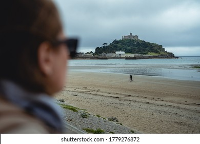 Saint michaels mount on an overcast early morning with stormy clouds and cool tones