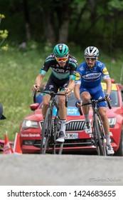 Saint Michel de Maurienne, France. Gregor Muehlberger of Bora Hansgrohe cycling Team and Julian Alaphilippe of Deceuninck-Quickstep Team at Col de la Baune climb on stage 6 Criterium du Dauphiné 2019