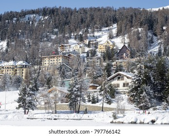 Saint Moritz town buildings during winter with snow and sun