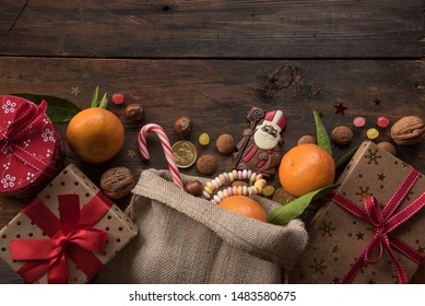 Saint Nicholas background with gifts, sweet candy, Chocolate and place for text