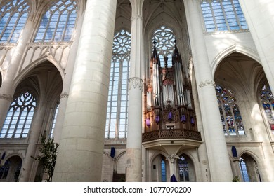 Saint Nicholas de Port, Lorraine / France - April 10 2018: Interior arches of the Saint Nicholas de Port Basilica with stained glass in the background