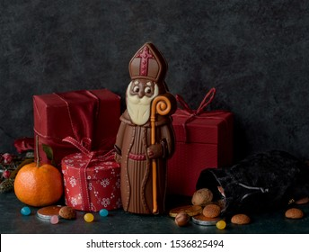 Saint Nicholas figurine in chocolate with gifts and candy