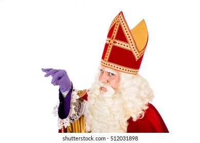 Saint Nicholas holding something in his hand  with space for atribute . isolated on white background. Dutch character of St. Nicholas