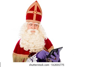Saint  Nicholas looking on  smart phone or tablet in his hand. Isolated on white background