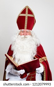 Saint Nicholas looks at you over his big book with a smile