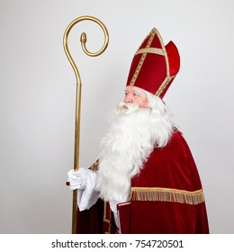 Saint Nicholas with mitre ans staff in profile on white