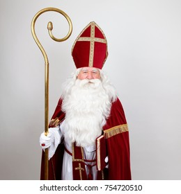 Saint Nicholas standing with his staff on white