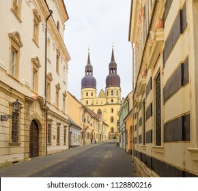 Saint Nicolas' Church and M. Schneidera Trnavskeho street in Trnava. Gothic cathedral and old town street in Trnava, Slovakia. St. Nicholas' Basilica build in the eastern part of the historical center