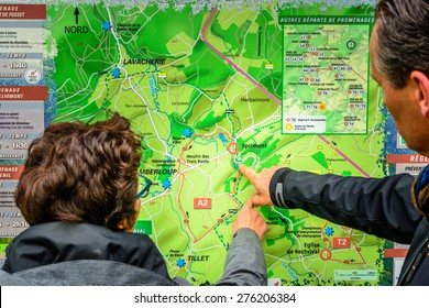 Saint Ode, Belgium - May 1 2015:Man and woman looking on a map to start a hike in Belgian Ardennes