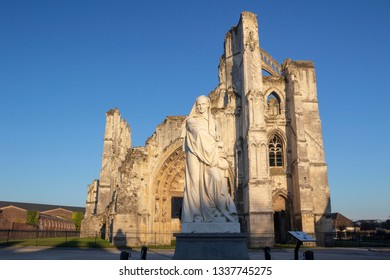 Saint Omer, Nord-Pas-de-Calais / France - 02/23/2019: Statue and ruins of the Abbey of Saint Bertin