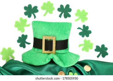 Saint Patrick day hat with clover leaves and golden coins, isolated on white