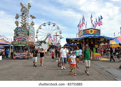 SAINT PAUL - AUGUST 27:  People walk through the midway at the Minnesota State Fair on Aug. 27, 2011 in St. Paul, Minnesota. Attendance averages about 140,000 per day in 2011.