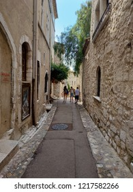 Saint Paul de Vence, France - July 9, 2018: St Paul De Vence is a beautiful medieval fortified village perched on a narrow spur between two deep valleys. Unidentified people walking down the street
