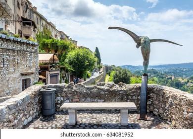 Saint Paul de Vence, France - June 30, 2016: day view of typical street with statue and panoramic view in Saint Paul de Vence, France. It is popular destination for artists, poets and writers.