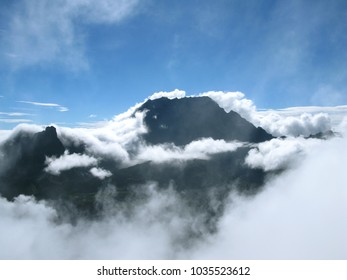 Saint Paul / La Reunion: View from the Maido peak over the Cirque de Mafate to the Piton des Neiges in the early morning when orographic clouds cover the landscape