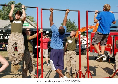 SAINT PAUL, MINNESOTA- SEPTEMBER 2:  Unidentified members of the US Marines test fair-goers for fitness at the Minnesota State Fair on September 2, 2012, in St. Paul, Minnesota.  Attendance has averaged 142.000 per day at the fair.