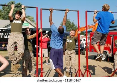 SAINT PAUL, MINNESOTA- SEPTEMBER 2:  Unidentified members of the US Marines test fair-goers for fitness at the Minnesota State Fair on September 2, 2012, in St. Paul, Minnesota.  Attendance has averaged 142.000 per day at the fair.