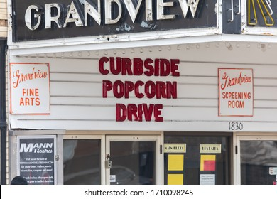Saint Paul, MN / USA - April 20th 2020: Theater closed during COVID-19 Coronavirus pandemic holds curbside popcorn drive.