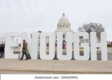 SAINT PAUL, MN/USA – MARCH 24, 2018: Protester holds sign on State Capitol mall  before students' arrival during March For Our Lives rally organized as part of a national protest against gun violence.