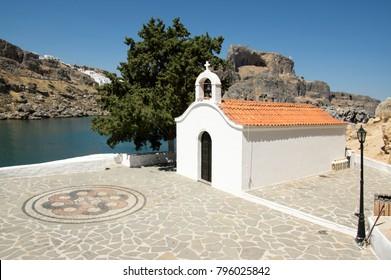 Saint Paul small white chapel near Lindos beach, popular place for weddings