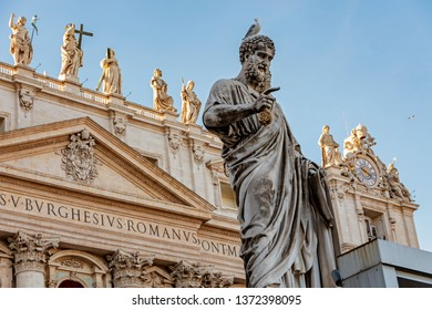 Saint Peter Basilica building with St Peter statue  in Vatican Rome
