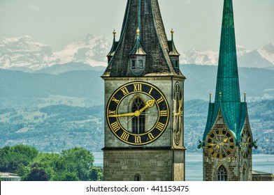 Saint Peter and Fraumünster Church in Zurich (Switzerland) in front of lake Zurich and the Swiss Alps, HDR-technique