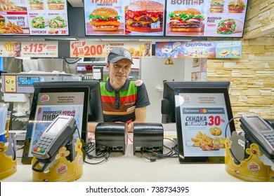 SAINT PETERSBURG - CIRCA SEPTEMBER, 2017: indoor portrait of worker at Burger King restaurant. Burger King is an American global chain of hamburger fast food restaurants.