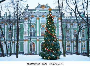 Saint Petersburg. Festively decorated Christmas tree with garlands and balls at the entrance to the Hermitage Museum in the winter snowy day