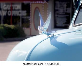 Saint Petersburg, FLA - Oct 26 2018 - Car figurehead emblem on a vintage GMC truck.