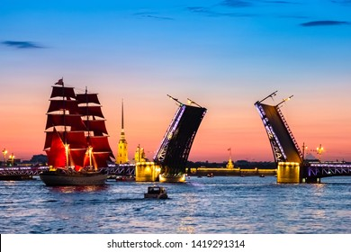 Saint Petersburg. Holiday Scarlet Sails. Russia. Evening Petersburg. Sailboat sailing on the Neva River. Holidays in the Russian Federation. Sailboat with scarlet sails. Summer evening.