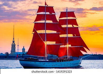 Saint Petersburg. Holiday Scarlet Sails. Russia. Sailboat sailing on the Neva River. Rasvet the sun on the background of the Peter and Paul Fortress. Holidays in the Russian Federation.