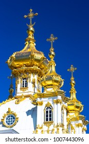 Saint Petersburg, PETERHOF, Russia. Palace church of Saint Peter and Paul in Peterhof Grand Palace. Clear blue sky.Golden domes and crosses.