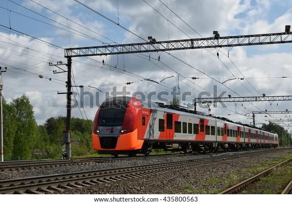 "Saint Petersburg Region (Leningradskaya Oblast), Russia - May 22, 2016. Lastochka (""The Sparrow"", or Siemens Desiro) EMU train from Petrozavodsk heads to Saint Peterburg at the Gory Station"