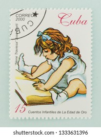 Saint Petersburg, RUSSIA - 06 March, 2019: A stamp printed in Cuba shows girl reading a book, circa 2000