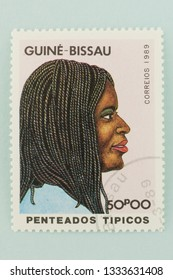 Saint Petersburg, RUSSIA - 06 March, 2019: A stamp printed in Cuba shows typical female hairstyles, Cuban, circa 1989