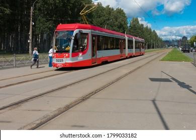 Saint Petersburg, Russia, 07.08.2020 Modern tram on the tracks of red in Saint Petersburg